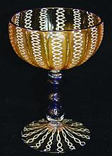 A VENETIAN LATTACHINE GLASS GOBLET