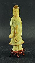 A CHINESE JADE-LIKE CARVED BOWENITE FIGURE OF