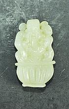 A SMALL WHITE JADE CARVING, modelled as a smiling