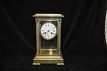 A 19TH CENTURY FRENCH BRASS FOUR GLASS CLOCK with