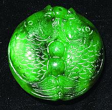 A CHINESE CARVED GREEN JADE CIRCULAR PENDANT, in