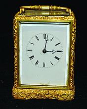 A 19TH CENTURY FRENCH BRASS CARRIAGE CLOCK in a