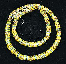 A ROMAN YELLOW GLASS NECKLACE