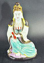 A CHINESE PORCELAIN FIGURE OF GUANYIN, the deity's