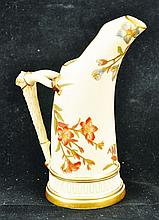 A ROYAL WORCESTER ELEPHANT TUSK JUG painted and