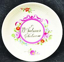 AN 18TH CENTURY GERMAN SAUCER inscribed F.V Sudman