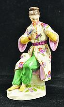 A 19TH CENTURY MEISSEN FIGURE OF A CHINESE YOUNG