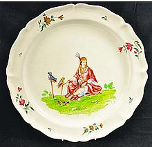 AN 18TH CENTURY CONTINENTAL FAIENCE DISH painted