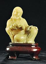 A CHINESE CARVED SOAPSTONE FIGURE OF A LOHAN,