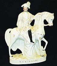 A FIGURE SEATED ON HIS HORSE, in white and gilt, a