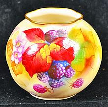 A ROYAL WORCESTER GLOBULAR POT painted with