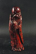 A 19TH CENTURY CHINESE CARVED HARDWOOD FIGURE OF