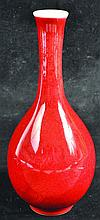A CHINESE SANG-DE-BOEUF PORCELAIN BOTTLE VASE,