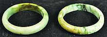 A PAIR OF CHINESE SPINACH GREEN JADE BANGLES, with