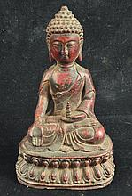 A CHINESE BRONZE FIGURE OF BUDDHA, seated upon a