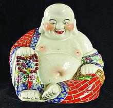A CHINESE FAMILLE ROSE PORCELAIN FIGURE OF BUDAI,