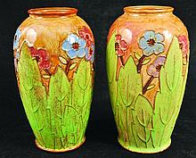 A PAIR OF ROYAL DOULTON STONEWARE TUBE LINED VASES