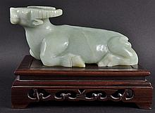 A CHINESE CARVED JADE MODEL OF A BUFFALO,