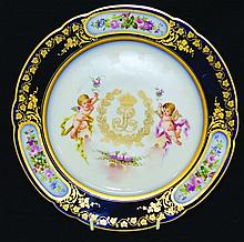 A SEVRES PLATE, rich blue and gilt border with
