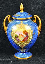 A ROYAL WORCESTER POWDER BLUE VASE AND COVER