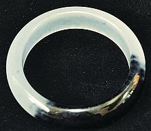 A CHINESE JADE BANGLE, the semi-translucent white