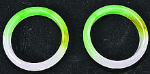 A PAIR OF CHINESE FU LU SHAO JADE BANGLES, the