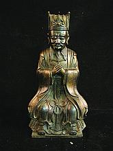 A CHINESE BRONZE FIGURE OF A DEITY, seated on a