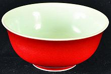 A CHINESE RED GLAZED PORCELAIN BOWL, the base with