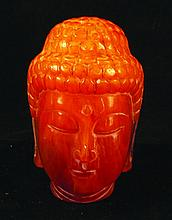 A CHINESE AMBER TYPE MODEL OF BUDDHA'S HEAD, the