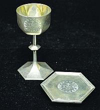 A RARE VICTORIAN SILVER TRAVELLING COMMUNION SET