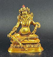 A 19TH/20TH CENTURY TIBETAN GILT BRONZE FIGURE OF
