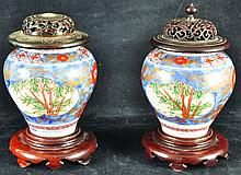 A PAIR OF JAPANESE IMARI PORCELAIN VASES, with