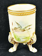 A ROYAL WORCESTER THREE-FOOTED GILT AND JEWELLED