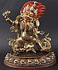 AN UNUSUAL CHINESE TIBETAN GILT BRONZE FIGURE OF