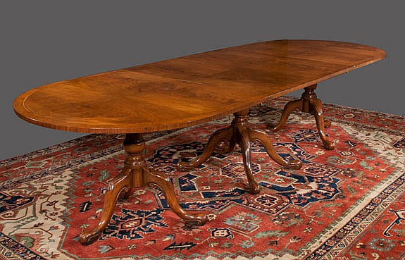 Three pedestal Queen Anne style walnut dining table with cross-banded top, herringbone inlay, pedestals have urn shaped columns, cabriole legs and pad feet, c.1900, 10'6
