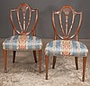 Set of six Sheraton style mahogany dining chairs with shield shape, fleur di leis carved backs, tapered legs and spade feet, c.1900, 22