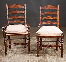 Set of six oak ladder back chairs including two armchairs and four sides having rush seats and tie on pillows on pad feet; armchairs-23
