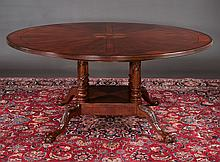 Chippendale style mahogany circular dining table with inlaid top, base has four columns resting on the platform base and four cabriole legs on ball and claw feet, 66