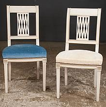 Group of nine painted dining chairs with scroll backs, upholstered seats and square tapered legs, 18