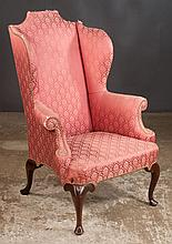 Queen Anne style mahogany wing chair on cabriole legs with pad feet, 32
