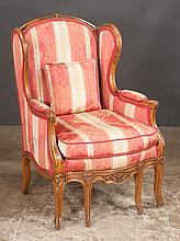Louis XV carved walnut bergere with carved back and carved cabriole legs, unusual foot stool that pulls out from the apron, c.1900, 28