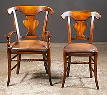 Set of ten Sheraton style mahogany dining chairs with urn shaped splat backs, leather seats with brass nail trim and splay legs by Theodore Alexander; armchairs 22