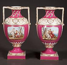 Pair of KPM maroon and gold porcelain urns with scenic and figural decoration, and pierced design in the neck, c.1900, 13