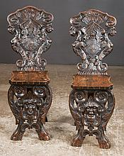 Pair of Jacobean style oak hall chairs with lion heads and scroll carved backs, c.1890, 12