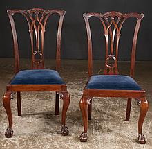 Set of four Chippendale style mahogany dining chairs with carved backs, cabriole legs and ball and claw feet, c.1900, 22