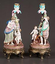 Pair of porcelain figural candlesticks with leaf and grape decoration, 13.5