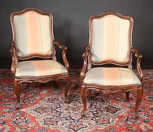 Pair of Louis XV walnut fauteuils with carving at the crest of the backs, caved aprons and cabriole legs, c.1800, 26