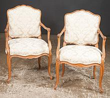 Pair of French style fruitwood armchairs with shaped aprons and cabriole legs, 21