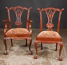 Set of eight Chippendale style mahogany dining chairs with interlaced carved backs, cabriole legs with carved knees and ball and claw feet, armchairs 25
