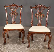 Pair of Chippendale style mahogany side chairs with carved backs, carved cabriole legs and scroll feet, 22